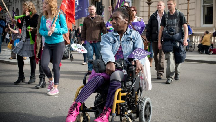 Woman in wheelchair attending UNISON march and rally