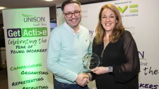 Shawn Fleming accepting an award from Debi Potter at UNISON's Get Active Awards Ceremony 2019