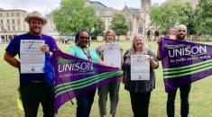Members of Bristol UNISON branch hold purple and green UNISON flags and zero tolerance campaign posters to show support for the summer appeal.